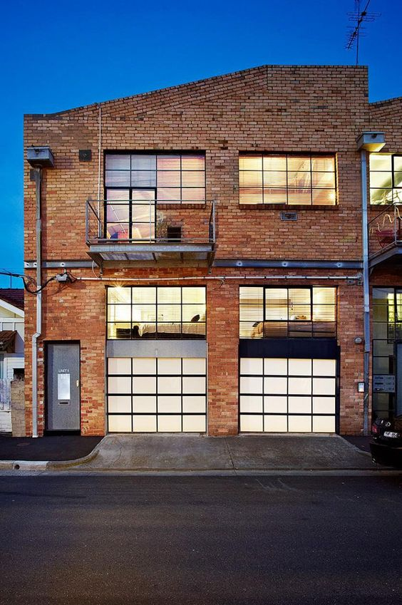 The Strelein Warehouse, located in Sydney, Australia, was converted into a 2-floor residence by Ian Moore Architects.